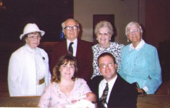 All of our living grandparents at our older daughter's Baptism.