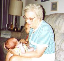 The Lovely Nana holds our older daughter as an infant. She had been Baptized on Nana's birthday.